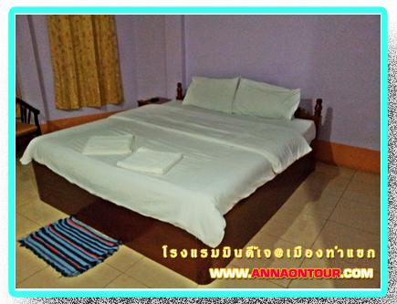 เตียงนอนในห้องพักโรงแรมมินดี้เจ minde j Hotel